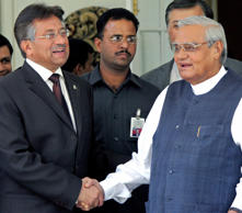 File: Pakistan's President Pervez Musharraf (L) shakes hands with Atal Behari Vajpayee (R), former Indian prime minister and leader of India's main opposition Bharatiya Janata Party, after their meeting in New Delhi April 18, 2005. Declaring their peace process irreversible, nuclear rivals India and Pakistan agreed on Monday to open up the heavily militarised frontier dividing Kashmir, capping a successful visit by Musharraf.