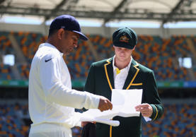 Steve Smith of Australia and MS Dhoni of India meet for the coin toss during day one of the 2nd Test match between Australia and India at The Gabba on December 17, 2014 in Brisbane, Australia.