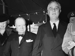 President Franklin Roosevelt, Prime Minister Winston Churchill and members of their party leave the White House in Washington on Dec. 25, 1941 for Christmas services at the foundry Methodist church.