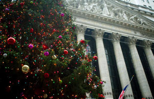The exterior of the New York Stock Exchange is pictured with a Christmas tree in front of it in the Manhattan Borough of New York, Dec. 23, 2014.