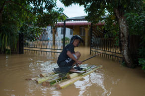 A man makes his way to his house submerged in floodwaters in Pengkalan Chepa, near Kota Bharu on December 27, 2014.