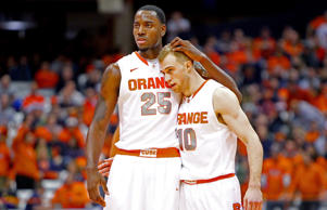 Rakeem Christmas of the Syracuse Orange reacts after a play with teamate Trevor Cooney during the game against the Monmouth Hawks in Syracuse, NY.