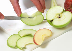Person slicing an apple