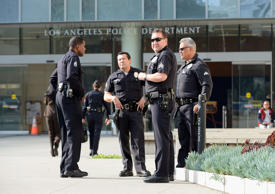 Los Angeles Police Department officers are deployed around the police headquarters on February 7, 2013 in Los Angeles, California.