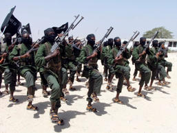 In this Thursday, Feb. 17, 2011 file photo, hundreds of newly trained al-Shabab fighters perform military exercises in the Lafofe area some 18km south of Mogadishu, in Somalia.