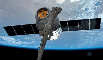 The SpaceX Dragon commercial cargo spacecraft is grappled to Canadarm2 at the International Space Station in this NASA picture taken April 20, 2014. NASA/Reuters