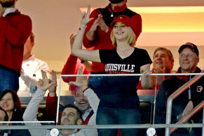 Jennifer Lawrence acknowledges the crowd while attending an NCAA basketball game between the Kentucky Wildcats and the Louisville Cardinals on Dec. 27, 2014, at the KFC YUM! Center in Louisville, Ky.