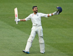 Virat Kohli celebrates after reaching his century during day three of the Third Test match between Australia and India at Melbourne Cricket Ground on December 28, 2014 in Melbourne, Australia.