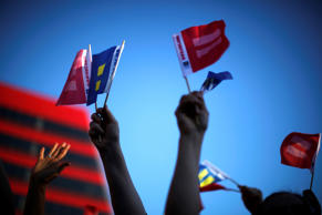 People wave marriage equality flags in West Hollywood, Calif.