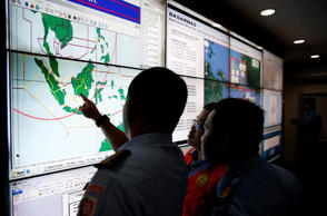 Military and rescue authorities monitor progress in the search for AirAsia Flight QZ8501 in the Mission Control Center inside the National Search and Rescue Agency in Jakarta December 29, 2014.``