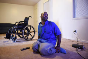 Kelvin Cook sits near his television shortly after getting his cable installed at his apartment on Monday December 15, 2014 in Concord, N.C.