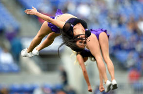 Baltimore Ravens cheerleaders perform in the first half of an NFL football game against the Cleveland Browns, Sunday, Dec. 28, 2014, in Baltimore.