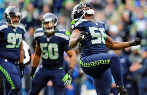 Seattle Seahawks defensive end Cliff Avril celebrates after sacking St. Louis Rams quarterback Shaun Hill Dec. 28 in Seattle.