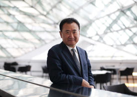 Billionaire Wang Jianlin, chairman and president of Dalian Wanda Group, poses for a portrait at the World Economic Forum Annual Meeting Of The New Champions in Dalian, China, on Wednesday, Sept. 11, 2013.