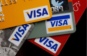 Visa credit cards are arranged on a desk February 25, 2008 in San Francisco, California. Justin Sullivan/Getty Images