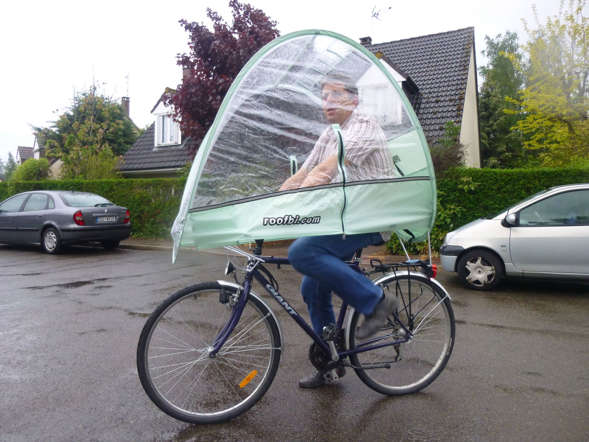 Frenchman Arnaud Sarfati has created a quirky canopy weighing 2.5 kg that unfolds over a bicycle rider and protect him from the rain.