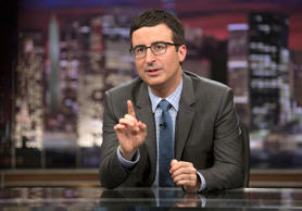 "John Oliver speaks during an April 2014 taping of ""Last Week Tonight with John Oliver,"" in New York."