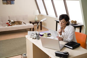 Woman working in home office.