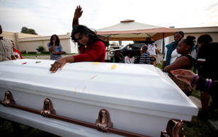 Mourner Paulisha dances in a tribute to Deshwanda Sanchez before her burial at Angeles Abby Memorial Park in Compton, Calif., on December 19, 2014.