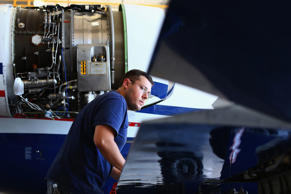 FlexJet Avionics Technician Ryan Settlemire works on a Learjet 45 aircraft at the Addison Airport on June 13, 2013 in Addison, Texas.
