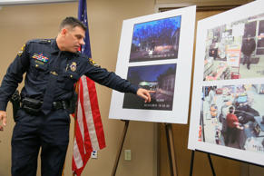Omaha Police Chief Todd Schmaderer points during a news conference in Omaha, Neb., Thursday, Feb. 26, 2015, to pictures taken by a police cruiser camera and store security cameras of robbery suspect Danny Elrod who was killed Monday by police. Elrod died after being shot by Officer Alvin Lugod. Authorities later determined that Elrod was unarmed.