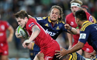 James O'Connor of the Reds on the attack during the round three Super Rugby match between the Highlanders and the Reds at