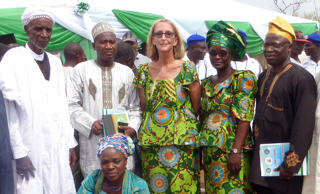 In this undated photo provided by Mike Henry, Seattle missionary Rev. Phyllis Sortor, standing at center with a delegation of area dignitaries in a town in Nigeria. Sortor, described by friends as courageous, tenacious and passionate about helping the people of Nigeria, has been abducted from a school in the violence-torn African nation, her church says.