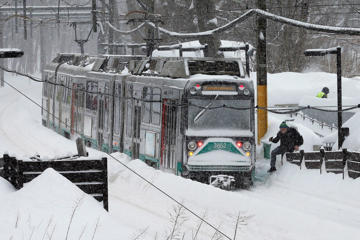 An MBTA green line subway train sits at a station during a winter snow storm in Brookline, Massachusetts February 9, 2015.