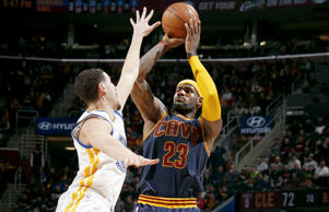 LeBron James #23 of the Cleveland Cavaliers shoots against the Golden State Warriors at The Quicken Loans Arena on February 26, 2015 in Cleveland, Ohio.