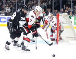 Kyle Turris #7 of the Ottawa Senators clears a rebound away from Jarret Stoll #28 of the Los Angeles Kings as Andrew Hammond #30 looks on during the second period at Staples Center on February 26, 2015 in Los Angeles, California.