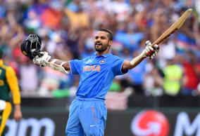 India's Shikhar Dhawan celebrates after scoring a century against South Africa during their Cricket World Cup pool B match in Melbourne, Australia, Sunday, Feb. 22, 2015.