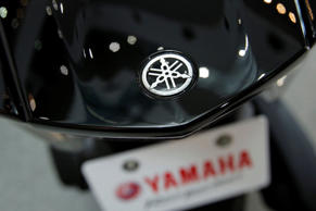 The Yamaha Motor Co. logo sits on a Tricity three-wheeled scooter with Leaning Multi Wheel (LMW) mechanism on display at the company's showroom in Iwata, Shizuoka Prefecture, Japan, on Thursday, Feb. 26, 2015.
