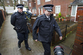 Law enforcement patrol a property at Leeve House on Lancefield Street in West London, believed to be a former address of ISIS terrorist Jihadi John who has been identified as Mohammed Emwazi on Thursday, Feb. 26, 2015.