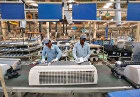 Workers assemble air conditioners in a factory in Rajasthan, India, October 1, 2014.