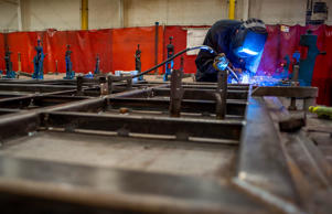 An employee welds the shell frame of a train car at the Siemens Industry Inc. manufacturing facility in Sacramento, California, U.S., on Thursday, Feb. 12, 2015. The U.S. Federal Reserve is scheduled to release industrial production figures on Feb. 18.