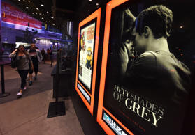 "People arrive to watch the film ""Fifty Shades of Grey"" on its opening day in Los Angeles on February 12, 2015."