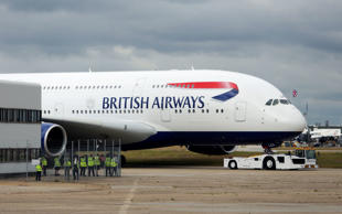 BA owner upgrades profits forecast by 20%