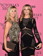 British model Abbey Clancy (R) and her mother Karen Sullivan pose for pictures on the pink carpet upon arrival for the 2014 Victoria's Secret Fashion Show at Earl's Court exhibition centre in London on December 2, 2014.