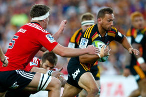 Aaron Cruden of the Chiefs is tackled during the round three Super Rugby match between the Chiefs and the Crusaders.