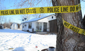 Police tape surrounds one of five crime scenes near Tyrone, Mo., Feb. 27, 2015.