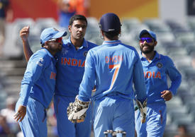 India's R Ashwin 2nd left, celebrates with team mates Suresh Raina left, captain M S Dhoni center, and Rohit Sharma right, after taking the wicket of United Arab Emirates K. Karate during their Cricket World Cup Pool B match in Perth, Australia, Saturday, Feb 28, 2015.