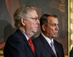 Senate Majority Leader Mitch McConnell of Ky., left, and House Speaker John Boehner of Ohio, stand together on Capitol Hill in Washington, Feb. 13, 2015.