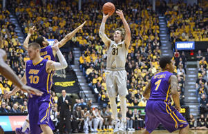Guard Ron Baker #31 of the Wichita State Shockers hits a three point shot against the Northern Iowa Panthers during the first half on February 28, 2015 at Charles Koch Arena in Wichita, Kansas.