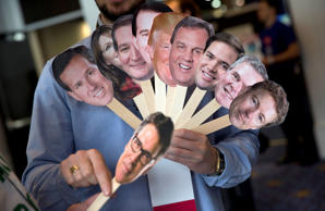 A reporter at the Conservative Political Action Conference in National Harbor, Md., Thursday, Feb. 26, 2015, holds images of possible Republican candidates, (from left) former Pennsylvania Sen. Rick Santorum; former Alaska Gov. Sarah Palin; Sen. Ted Cruz, R-Texas; Wisconsin Gov. Scott Walker; Donald Trump; New Jersey Gov. Chris Christie; Sen. Marco Rubio, R-Fla.; former Florida Gov. Jeb Bush; Sen. Rand Paul, R-Ky.; and, former Texas Gov. Rick Perry, below.