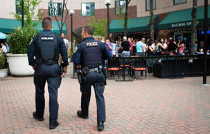 Police patrol past Mad Rose Tavern in Arlington, VA., May 3, 2014.