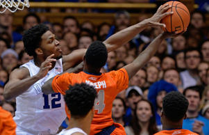 Justise Winslow #12 of the Duke Blue Devils blocks a shot by Kaleb Joseph #14 of the Syracuse Orange during their game at at Cameron Indoor Stadium on Feb. 28, 2015 in Durham, N.C.