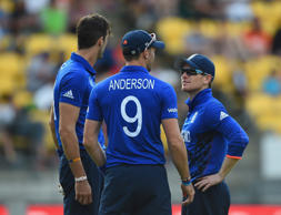 Eoin Morgan of England talks to bowlers Steven Finn and James Anderson during.