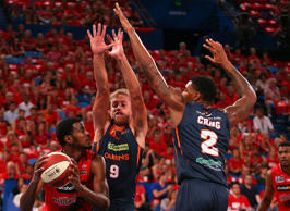 DeAndre Daniels of the Wildcats looks to pass against Mitchell Young and Torrey Craig of the Taipans during game two of the NBL Finals series between the Perth Wildcats and the Cairns Taipans.