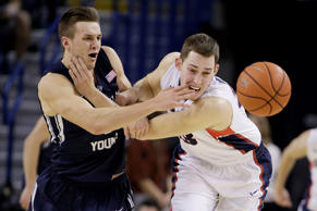 BYU's Kyle Collinsworth, left, and Gonzaga's Kyle Wiltjer go after a loose ball Saturday in Spokane, Wash. BYU upset the No. 3-ranked Zags 73-70.