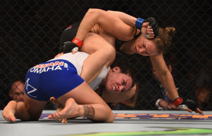 Ronda Rousey grapples with Cat Zingano in their UFC women's bantamweight championship bout during the UFC 184 event Feb. 28 in Los Angeles.
